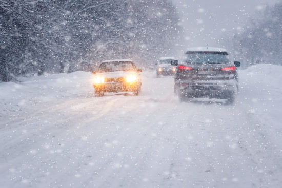 cars_driving_in_blizzard_on_snowy_road